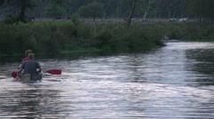 Dutch landscape river sunset canoeing people Stock Footage
