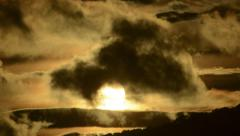Stormy sunset time lapse with cloud and sun silhouettes 4K version Stock Footage