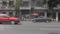 Historical old building background, cars driving fast, crowded lanes car traffic Stock Footage