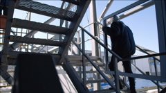 Workers carry the window frame up the stairs - Hard men's work - stock footage