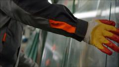 Worker puts the glass to transport - Insulating glass manufacture Stock Footage