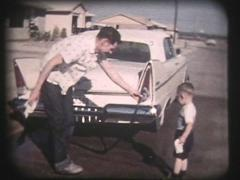 1950s Father And Son Wash Car - Vintage 8mm Stock Footage