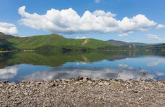 Derwent Water Lake District National Park Cumbria England blue sky to Catbells - stock photo