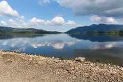 Derwent Water The Lakes Cumbria England uk blue sky sunny summer day - stock photo