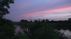 Dutch landscape river sunset canoeing people panshot Stock Footage