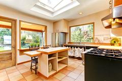 Bright kitchen room in old house Stock Photos