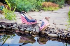 Marine sandals lie beside the pool Stock Photos