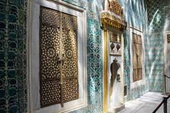 inlaid doors and mosaic tiles - stock photo