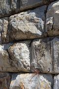 massive ashlar masonry wall - stock photo