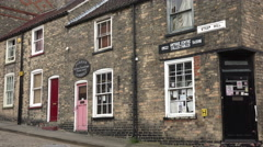 Houses along steep hill, lincoln, england Stock Footage