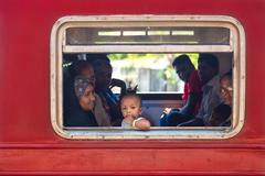 Local people in the train looking through window Stock Photos