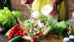 Woman adding cream to the vegetable salad, closeup Stock Footage