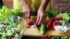 Woman cutting radish on the chopping board, closeup Stock Footage