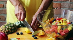 Woman cutting lemon into slices on the chopping board, closeup Stock Footage