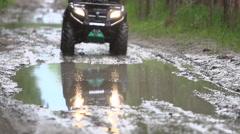 ATV on muddy road Stock Footage