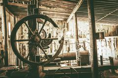 old barn equipment. barn interior in sepia color grading. - stock photo