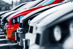 The one. car choice. cars stock with only one red car. Stock Photos