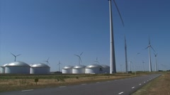 Vopak oil terminal and wind turbines at Groningen Seaports industrial area Stock Footage