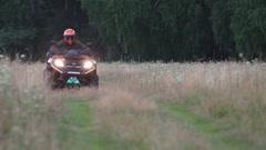 ATV on muddy road in rain Stock Footage