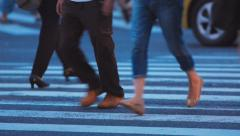 Anonymous people walking at a busy city intersection Stock Footage