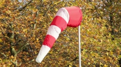 Windsock moving in the wind on clear day Stock Footage