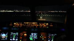 Airplane flight deck lining up with runway at night Stock Footage
