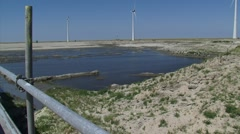 EEMSHAVEN, THE NETHERLANDS -  New port basin under construction, low water level Stock Footage