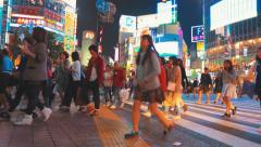 People crossing the street outside Stock Footage