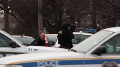 SWAT and policer officer running with guns drawn Stock Footage