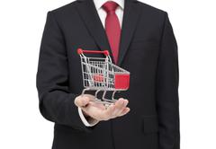 Shopping cart in businessman hand with clipping path - stock photo
