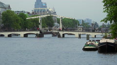 Stock Video Footage of Famous Magere Brug Bridge in Amsterdam over Amstel river