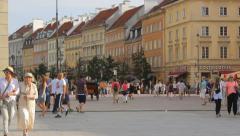 The old town of Warsaw with people, Krakowskie Przedmiescie street, panning Stock Footage