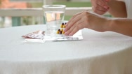 Stock Video Footage of Female Taking Medicine. Many Pills and Glass of Water.