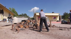 cutting fire wood at the Copper Canyon - stock footage