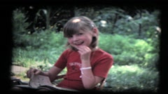 Family, two young girls in garden, grandma, vintage 8mm film Stock Footage