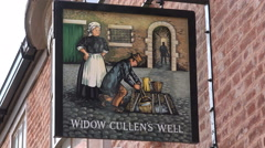 Widow cullens well shop sign board on steep hill, lincoln, england Stock Footage
