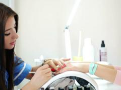 Woman painting finger nails in beauty salon NTSC - stock footage