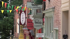 Shop signs and tea rooms along steep hill, lincoln, england Stock Footage