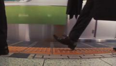 Business men walk on the subway platform in slow motion Stock Footage