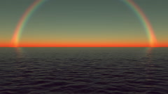 Rainbow over the water of the ocean in the evening. Loop background. Stock Footage
