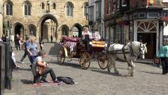 Horse and carriage, tourists at cathedral, castle square, lincoln, england Stock Footage