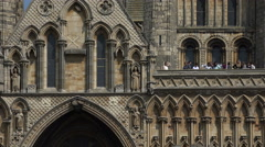 Zoom out to cathedral and tourists in castle square, lincoln, england Stock Footage