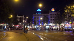 People waiting for the tram at Leidseplein by night Stock Footage