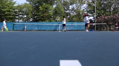 Slider shot showing a coach training a boy in Tennis Stock Footage