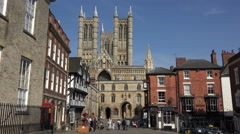 Cathedral and tourists in castle square, lincoln, england Stock Footage