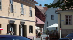 Square in old European medieval town, vacation, buildings, souvenir shop Stock Footage