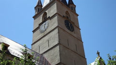14th century Lutheran Cathedral clock tower, Gothic style, tilt up Stock Footage