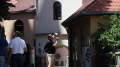 Man taking pictures, vacation, old European town, tourists, summer Stock Footage
