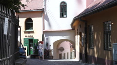 Young tourist using a map, medieval town, old buildings, historic center Stock Footage
