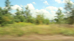 Passing scenery at train window Stock Footage